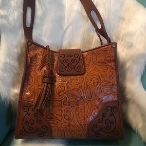 M.C. Tan Leather Embossed Handbag